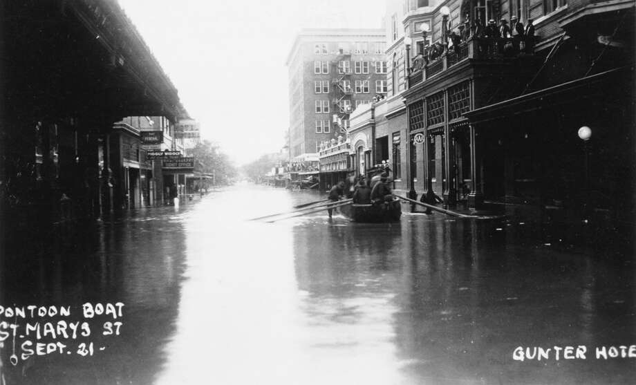 Soldiers floated in a boat down St. Mary's Street on Sept 21,1921 during flooding, which was a major downtown problem in the early 20th century. Photo: Courtesy Arcadia Publishing