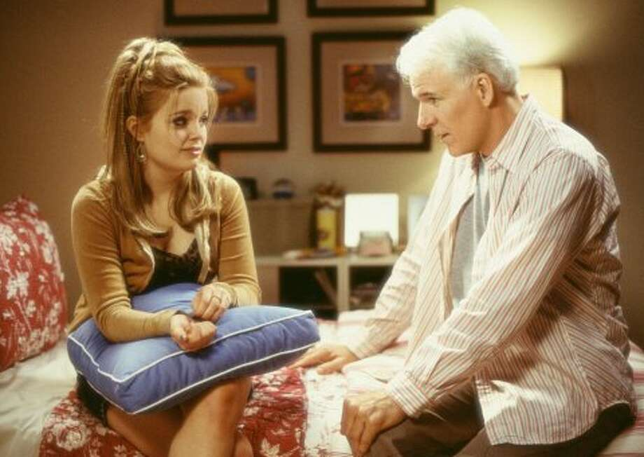 Steve Martin has a heart to heart with his daughter in Bringing Down the House (2003).