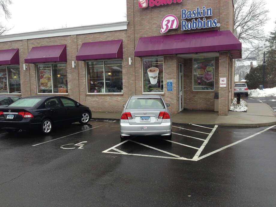Managing to block the walkway AND a handicap spot. Nice. Photo: Badparkingpics.com