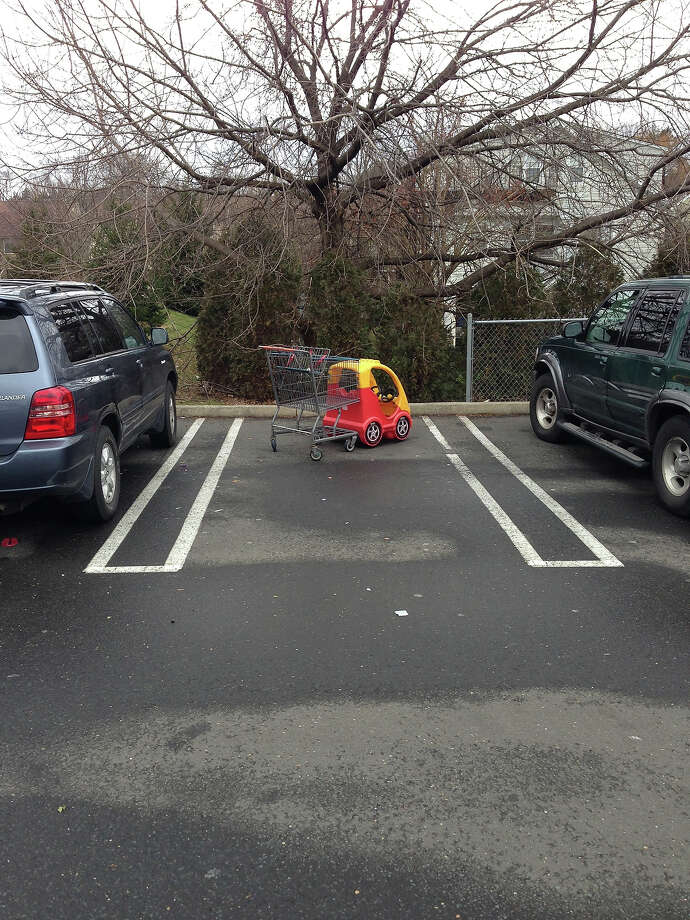 Small cars can be bad at parking, too.  Photo: Badparkingpics.com