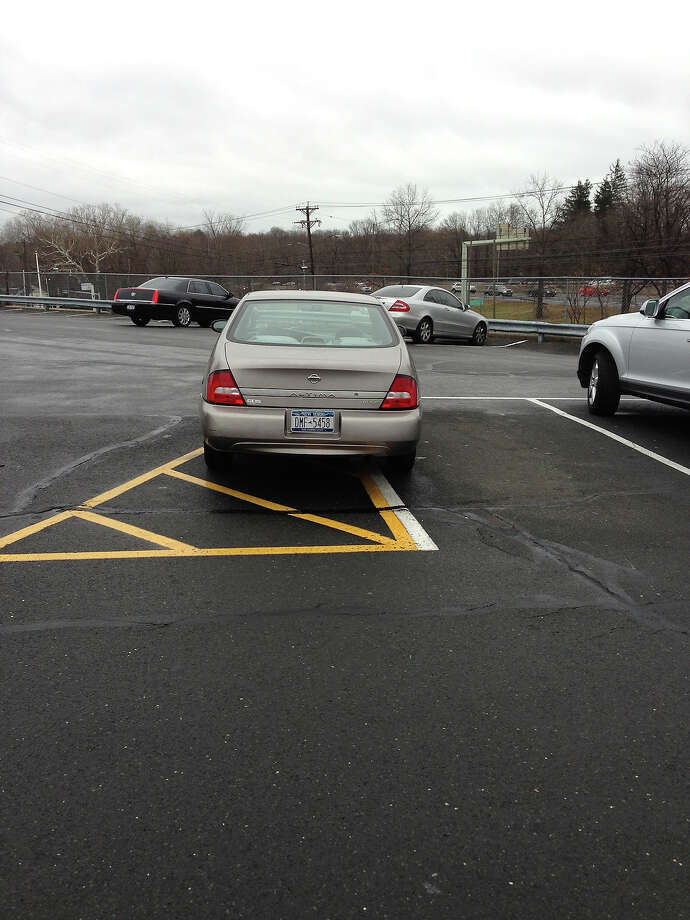 Because there was no where else to parking lot available.  Photo: Badparkingpics.com
