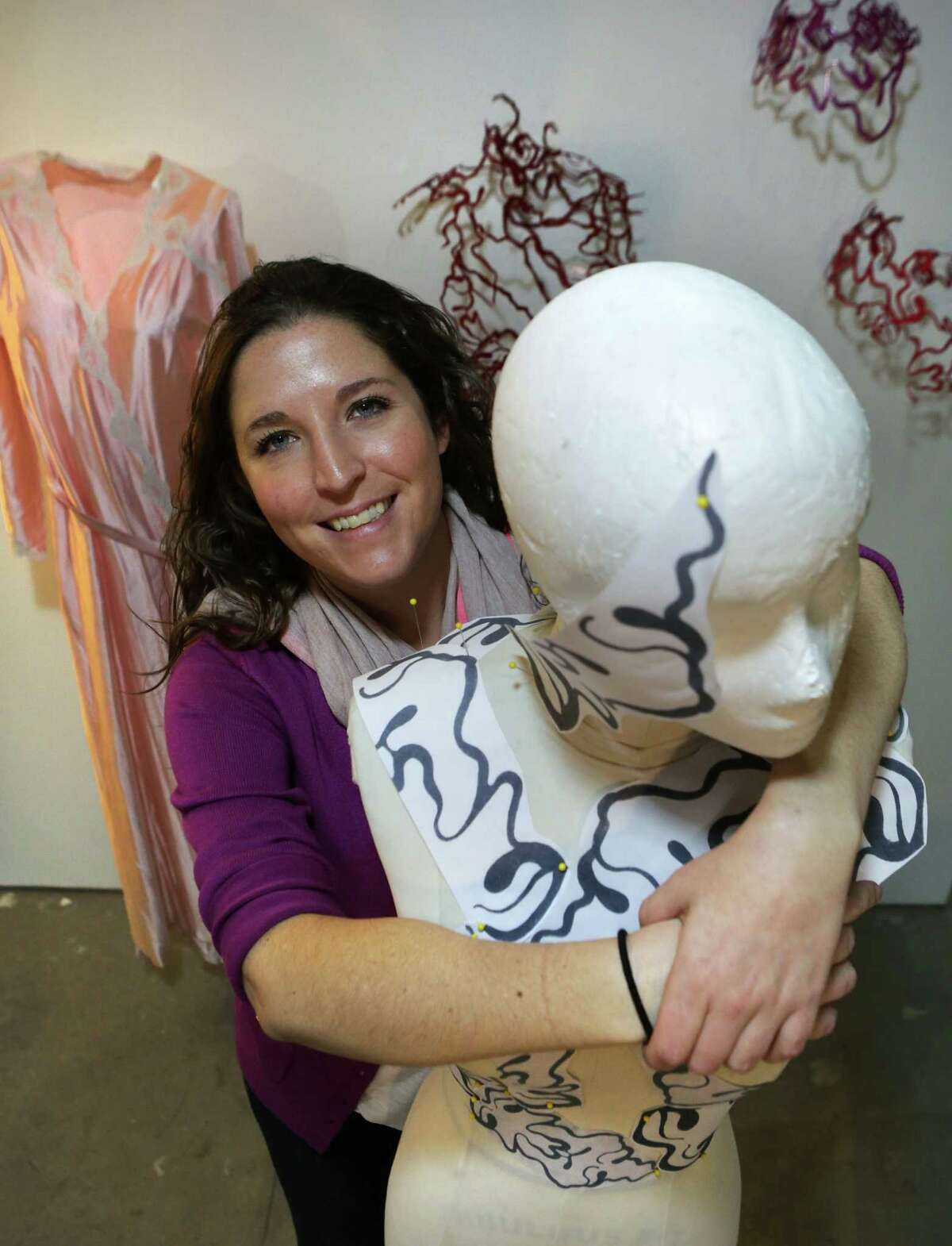 """Sarah Roberts, a graduate of Texas Tech University, is one of the artists who is participating in this year's """"On and Off Fredericksburg Road Studio Tour"""". Her artwork explores the trauma of loss, having lost her mother to breast cancer at an early age."""