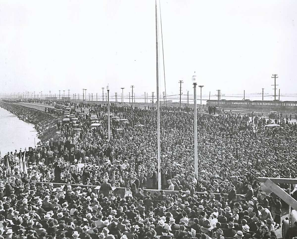 November 12, 1936 - California Governor Merriam addresses the crowd at opening day ceremonies of the Bay Bridge before the chain cutting on the East Bay side at the Oakland toll plaza. The governor then crossed to the San Francisco side and cut another chain. photographer unknown/ San Francisco Chronicle File 1936