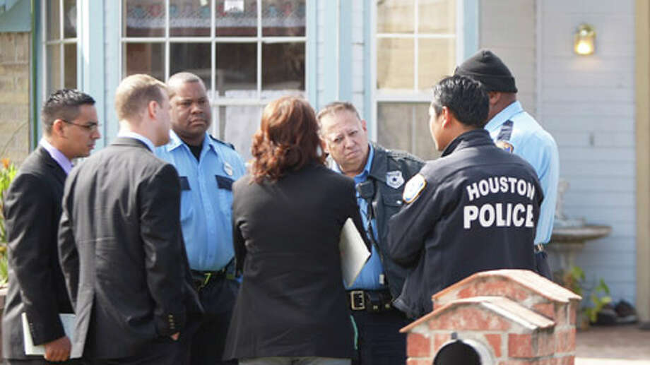 Homicide detectives arrive at the family house of the woman who told nurses she discarded her baby. Photo: .