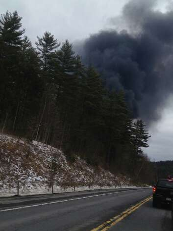 A column of smoke can be seen rising from where a tanker truck caught fire on Route 7 in Hoosick on Wednesday, Feb. 13, 2013. (Facebook)