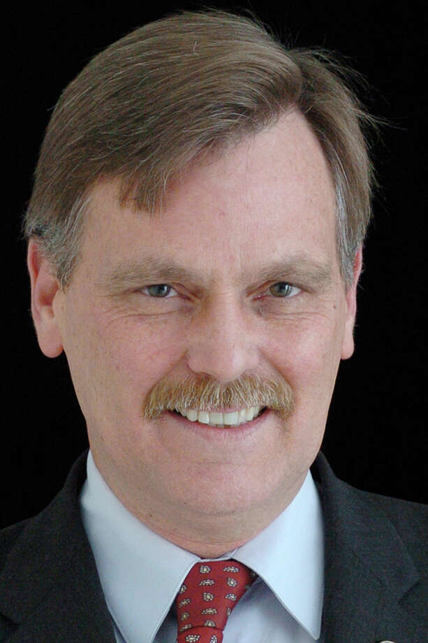 State Rep. John F. Hennessy, D-Bridgeport. Hennessy wants to change a state law that has allowed Bridgeport's elected officials to ignore a charter provision preventing them from being employed by the city, and governing it as councilmen. Photo: J Henninger, File Photo / Connecticut Post