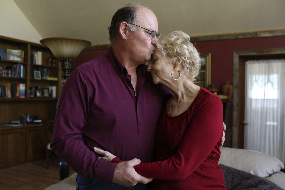 Pat Carlyon kisses his wife, Janet, who is fighting pancreatic cancer. Photo: Lisa Krantz / San Antonio Express-News