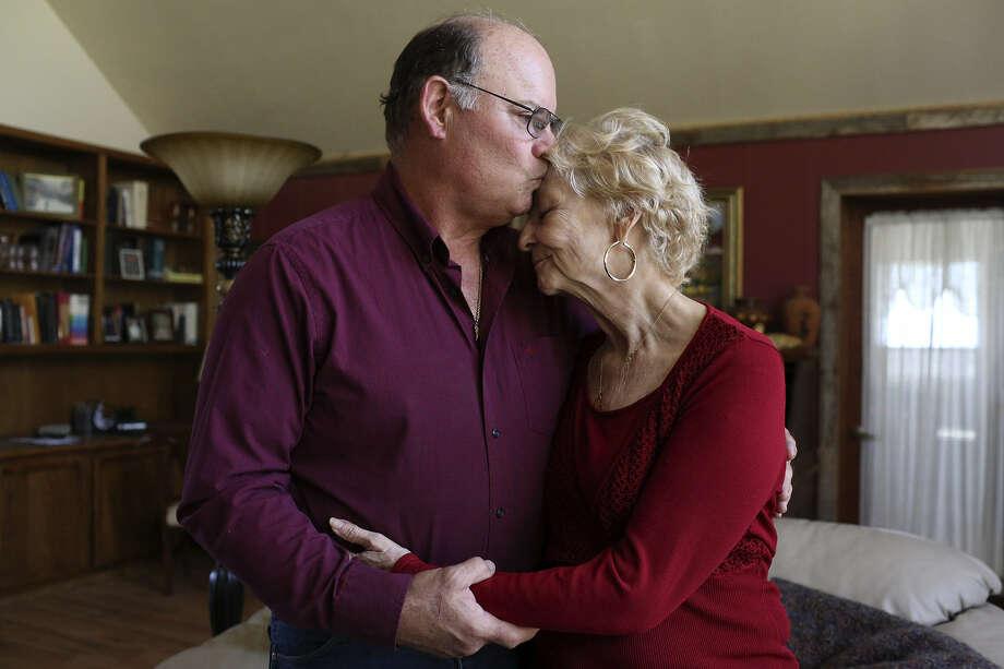 Pat Carlyon kisses his wife, Janet, who is fighting pancreatic cancer. Photo: Lisa Krantz / San Antonio Express-News