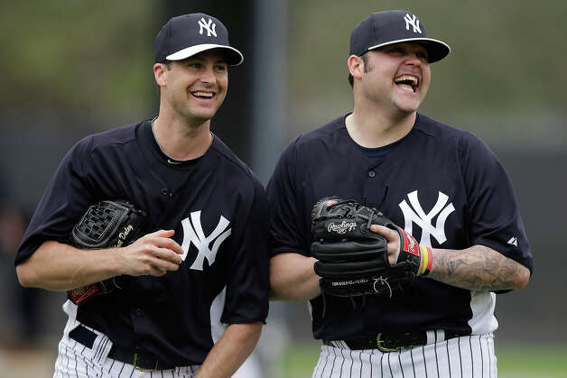 New York Yankees' Joba Chamberlain, right, laughs with non-roster invitee Matt Daley during a workout at baseball spring training, Wednesday, Feb. 13, 2013, in Tampa, Fla. (AP Photo/Matt Slocum) Photo: Matt Slocum, ASSOCIATED PRESS / AP2013