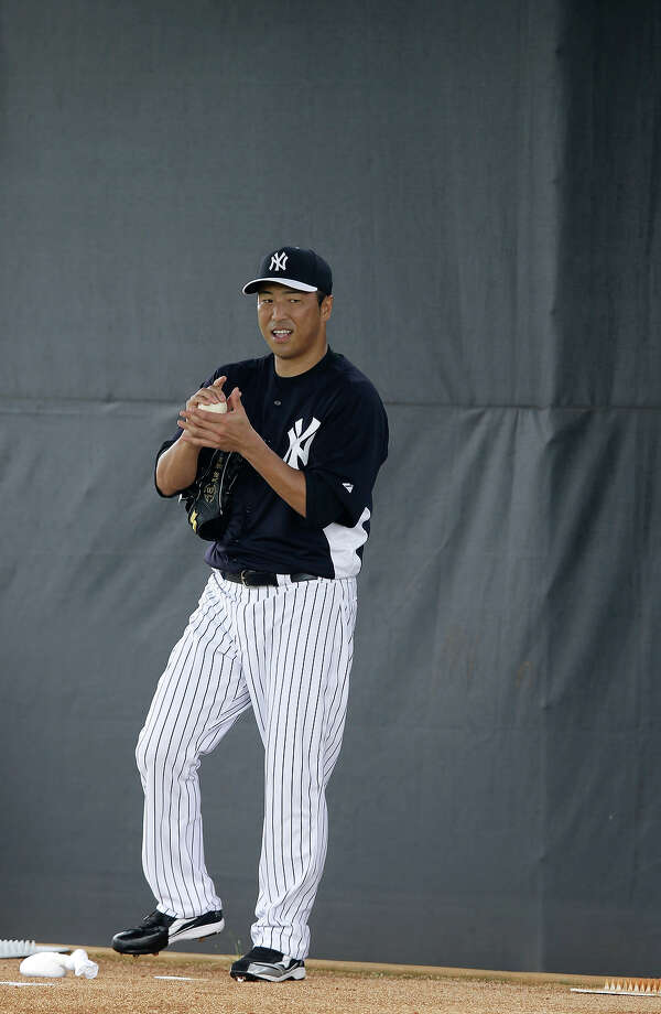 New York Yankees' Hiroki Kuroda, of Japan, rubs down a ball before throwing in the bullpen during a workout at baseball spring training, Wednesday, Feb. 13, 2013, in Tampa, Fla. (AP Photo/Matt Slocum) Photo: Matt Slocum, ASSOCIATED PRESS / AP2013