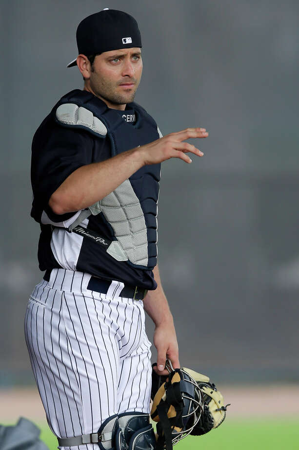 New York Yankees catcher Francisco Cervelli waves to a teammate during a workout at baseball spring training, Wednesday, Feb. 13, 2013, in Tampa, Fla. (AP Photo/Matt Slocum) Photo: Matt Slocum, ASSOCIATED PRESS / AP2013