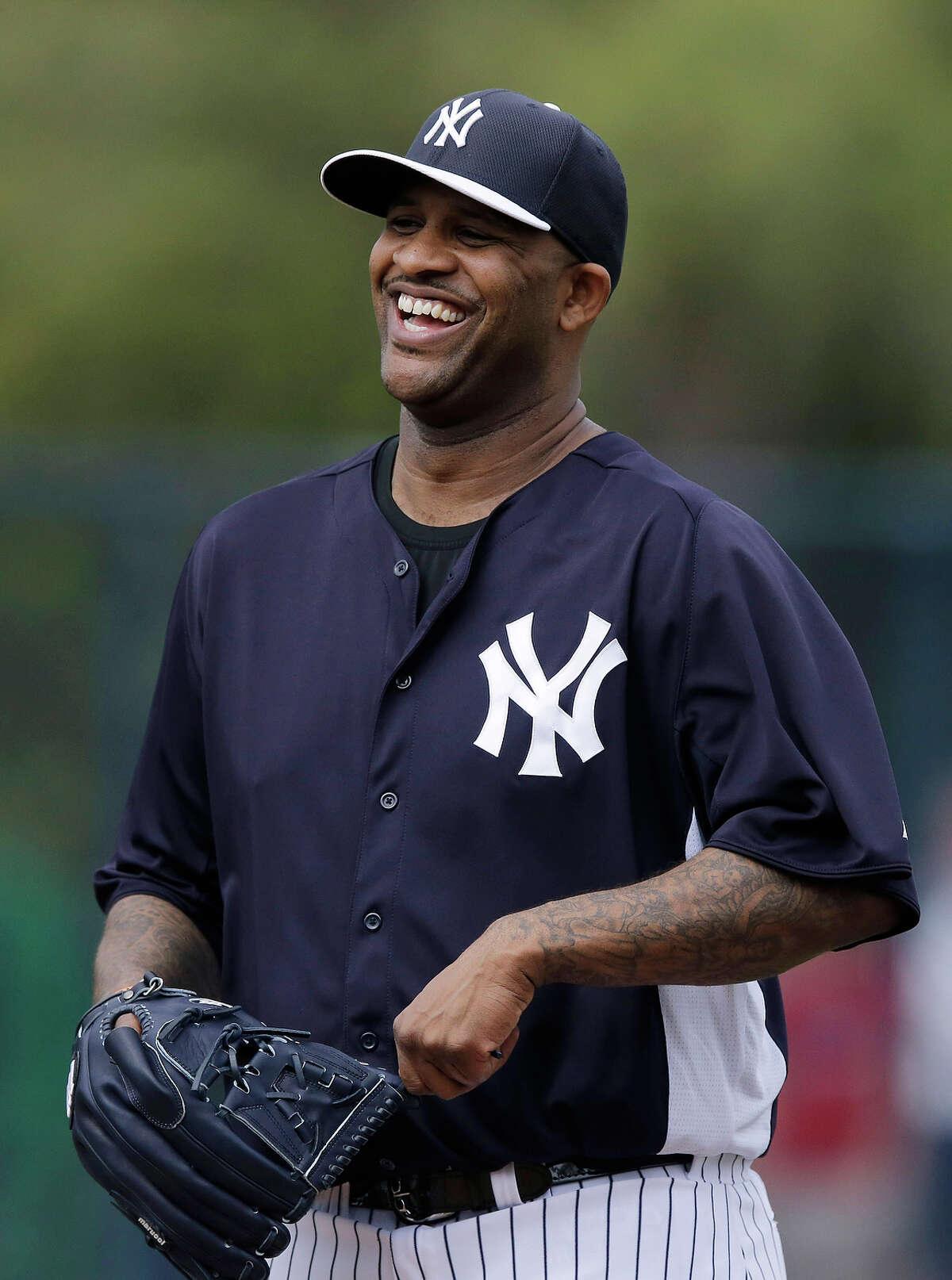 New York Yankees' CC Sabathia laughs during a workout at baseball spring training, Wednesday, Feb. 13, 2013, in Tampa, Fla. (AP Photo/Matt Slocum)