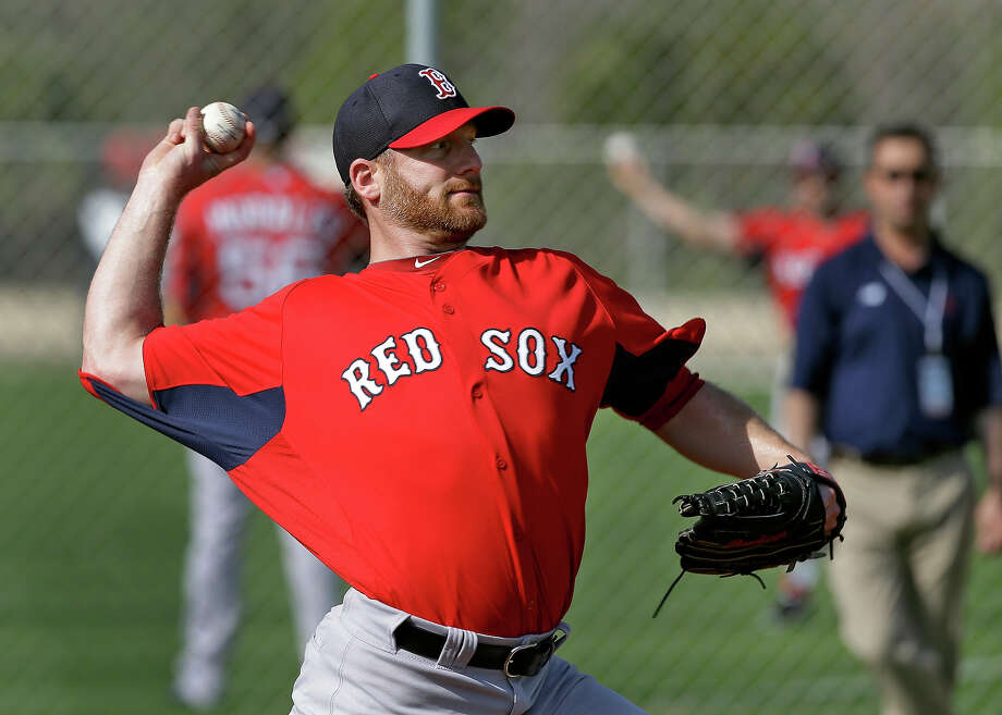Boston Red Sox pitcher Ryan Dempster throws a bullpen session during a spring training workout Wednesday, Feb. 13, 2013, in Fort Myers, Fla. Photo: Chris O'Meara, AP / AP