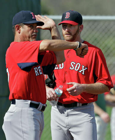 Boston Red Sox pitching coach Juan Nieves, left, works with pitcher Ryan Dempster during a spring training session Wednesday, Feb. 13, 2013, in Fort Myers, Fla. Photo: Chris O'Meara, AP / AP