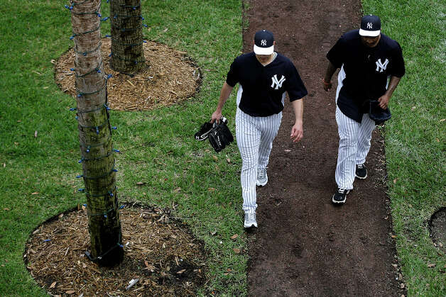 New York Yankees' Andy Pettitte, left, and CC Sabathia walk back to the clubhouse after a workout at baseball spring training, Wednesday, Feb. 13, 2013, in Tampa, Fla. (AP Photo/Matt Slocum) Photo: Matt Slocum, ASSOCIATED PRESS / AP2013