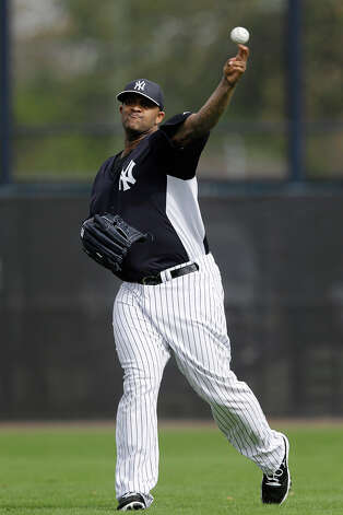 New York Yankees' CC Sabathia warms up during a workout at baseball spring training, Wednesday, Feb. 13, 2013, in Tampa, Fla. Photo: Matt Slocum, AP / AP