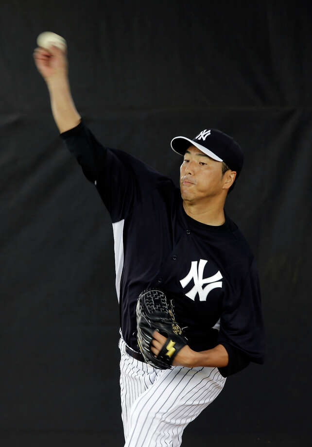 New York Yankees' Hiroki Kuroda, of Japan, throws in the bullpen during a workout at baseball spring training, Wednesday, Feb. 13, 2013, in Tampa, Fla. Photo: Matt Slocum, AP / AP