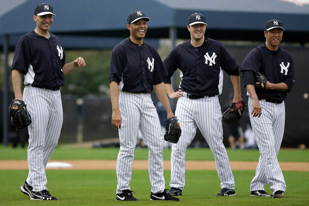 New York Yankees' Andy Pettitte, from left, Mariano Rivera, Phil Hughes and Hiroki Kuroda, of Japan, laugh during a workout at baseball spring training, Wednesday, Feb. 13, 2013, in Tampa, Fla. (AP Photo/Matt Slocum) Photo: Matt Slocum, ASSOCIATED PRESS / AP2013
