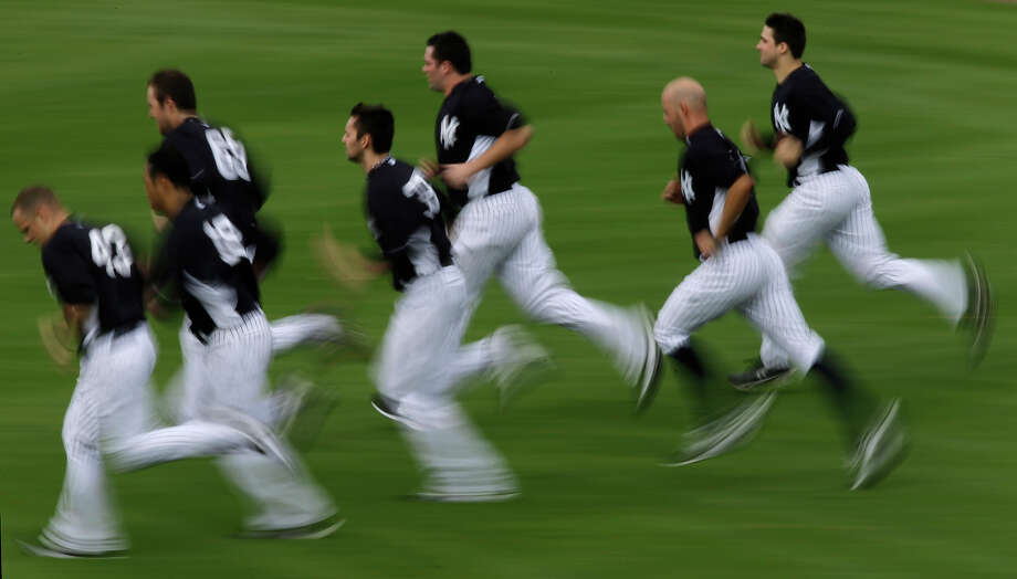 New York Yankees' pitchers and catches run sprints through the outfield after a workout at baseball spring training, Wednesday, Feb. 13, 2013, in Tampa, Fla. (AP Photo/Matt Slocum) Photo: Matt Slocum, ASSOCIATED PRESS / AP2013