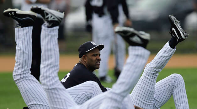 New York Yankees pitcher CC Sabathia, center,  stretches with teammates during a workout at baseball spring training, Wednesday, Feb. 13, 2013, in Tampa, Fla. (AP Photo/Matt Slocum) Photo: Matt Slocum, ASSOCIATED PRESS / AP2013