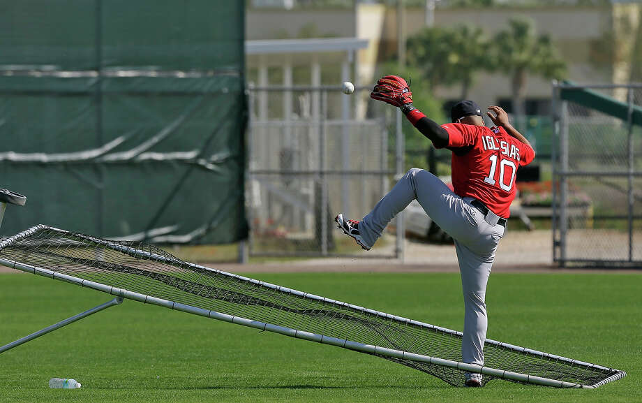 Boston Red Sox shortstop Jose Iglesias loses the ball as he crashes into a screen during a spring training workout Wednesday, Feb. 13, 2013, in Fort Myers, Fla. Photo: Chris O'Meara, AP / AP