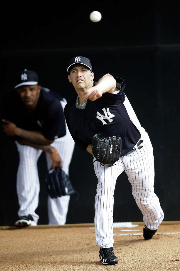 New York Yankees' Andy Pettitte, right, throws in the bullpen as CC Sabathia looks on during a workout at baseball spring training, Wednesday, Feb. 13, 2013, in Tampa, Fla. (AP Photo/Matt Slocum) Photo: Matt Slocum, ASSOCIATED PRESS / AP2013