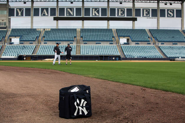 A bag filled with baseball sits on the field as the New York Yankees pitchers and catchers reported at George M. Steinbrenner Field Tuesday, Feb. 12, 2013, in Tampa, Fla. Photo: Scott Iskowitz, AP / 2012
