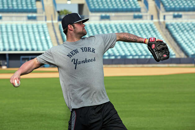 New York Yankees pitcher Joba Chamberlain throws the ball during baseball spring training at George M. Steinbrenner Field Tuesday, Feb. 12, 2013, in Tampa, Fla. (AP Photo/Scott Iskowitz) Photo: Scott Iskowitz, ASSOCIATED PRESS / 20122012