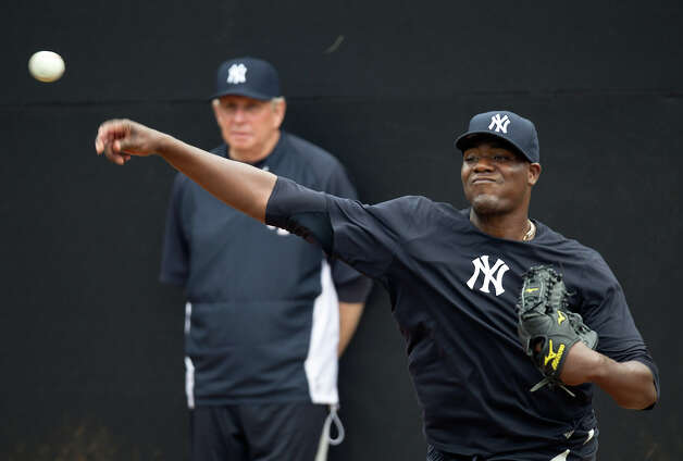 New York Yankees pitcher Michael Pineda throws the ball as pitching coach Larry Rothschild watches during baseball spring training at George M. Steinbrenner Field Tuesday, Feb. 12, 2013, in Tampa, Fla. (AP Photo/Scott Iskowitz) Photo: Scott Iskowitz, ASSOCIATED PRESS / AP2013