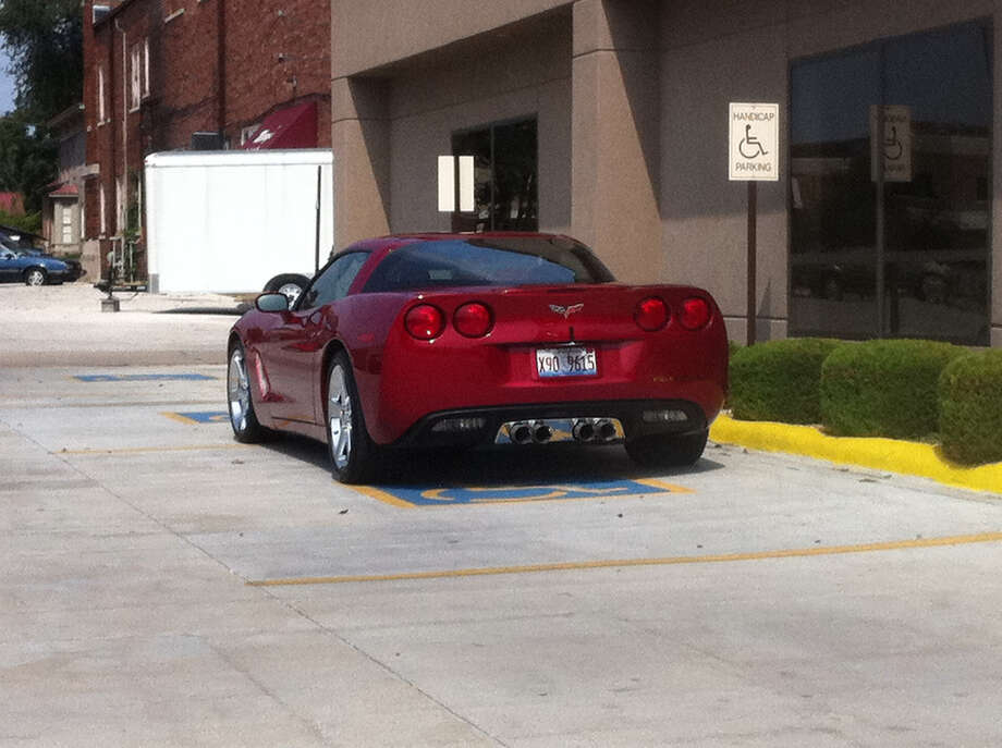 """""""Not only parked like a jerk...but parked like a jerk, in a sports car, in 2 handicapped spaces. It's a trifecta."""" Photo:  Joannapoe/Flickr.com"""