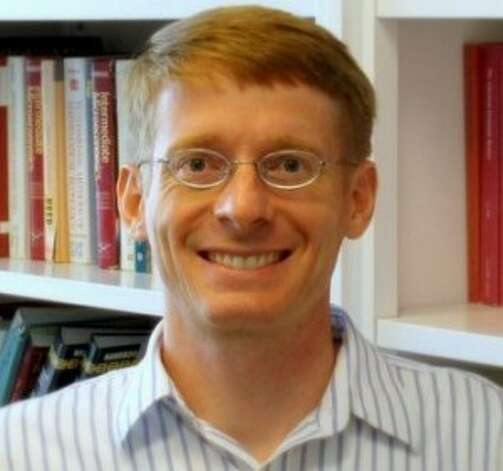 Steven Puller, associate professor of economics at Texas A&M, found that airline tickets purchased on weekends are more likely to be discounted than those bought during the week. Photo: Texas A&M