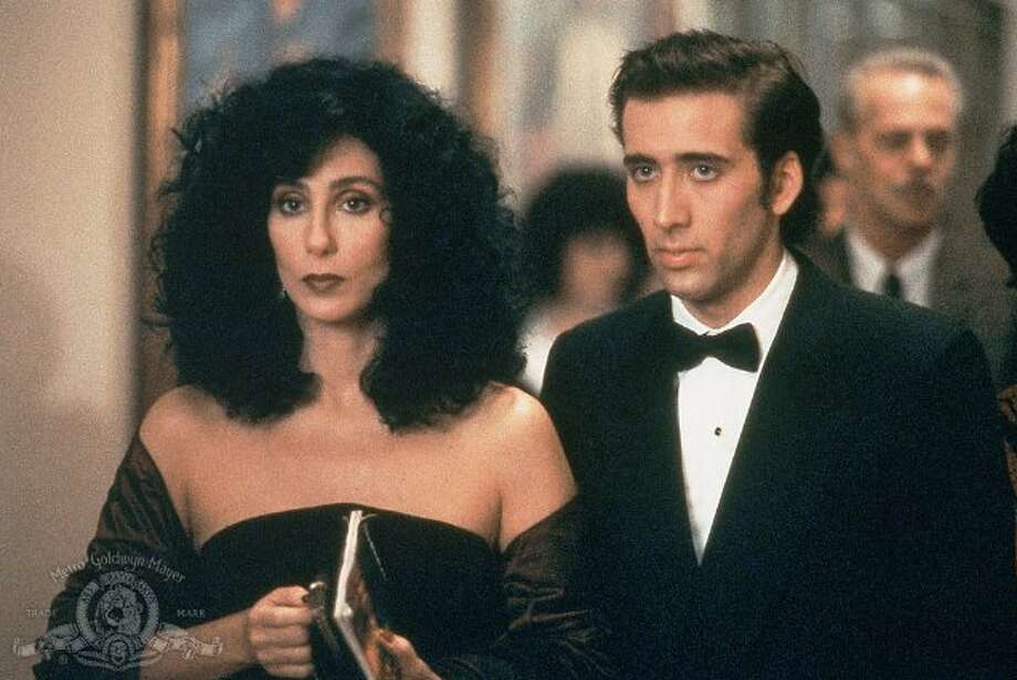 Ronny Cammareri (Nicolas Cage) and Loretta Castorini (Cher) in Moonstruck: Loretta is about to marry a nice fellow named Johnny because she thinks she ought to marry (not because she loves him). Then along comes Johnny's brother, Ronny, and Loretta is swept off her feet. Their romance shines when they go to the opera.