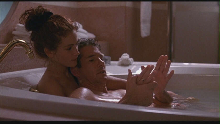 Edward Lewis (Richard Gere) and Vivian Ward (Julia Roberts) in Pretty Woman: He's a rich ruthless businessman; she's a prostitute. Together they find love in this 1990 film.