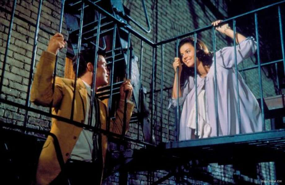 Tony (Richard Beymer) and Maria (Natalie Wood) in West Side Story: Two star-crossed teens from rival NYC gangs fall in love in this 1961 musical.
