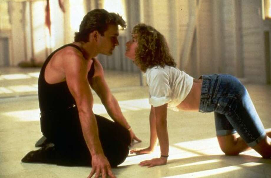 Johnny Castle (Swayze) and Frances 'Baby' Houseman (Jennifer Grey) in Dirty Dancing: They come from completely different backgrounds. He's a summer camp dance instructor. She's the young and intelligent daughter of a doctor. But through dancing they find common ground and the final scene when Baby does the lift successfully for the first time is a heart-stopper. The romance in this 1987 coming-of-age film is predictable but it made the teenagers swoon.