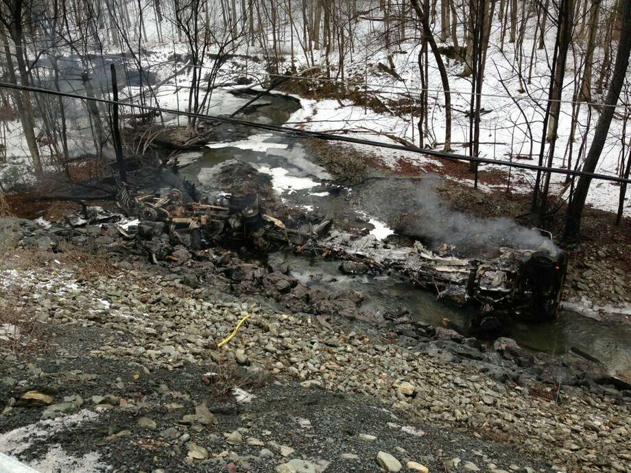 A tanker truck carrying 8,500 gallons of gasoline rolled off of Route 7 in Hoosick, plunged down a hillside and exploded near a creek on Wednesday, Feb. 13, 2013, fire officials said. (Skip Dickstein / Times Union)