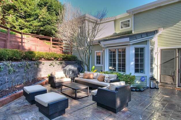 The backyard, above, includes a patio area that is an attractive spot for entertaining. Photo: Matt McCourtney