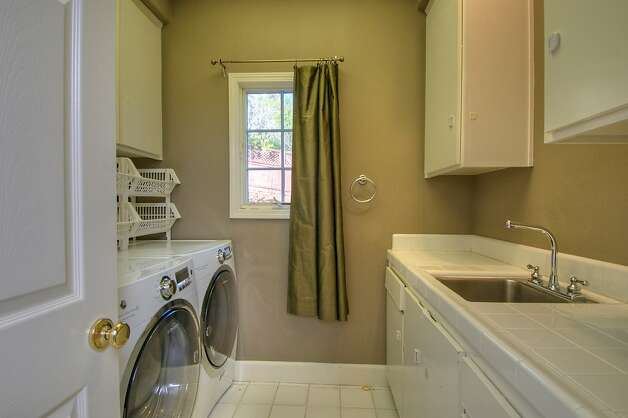 The home also has a laundry room with modern appliances. Photo: Matt McCourtney