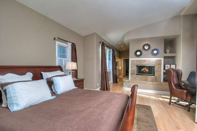The master suite features a sitting area and fireplace. Photo: Matt McCourtney
