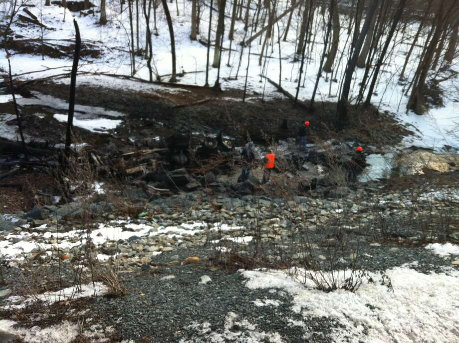 A tanker truck carrying 8,500 gallons of gasoline rolled off of Route 7 in Hoosick, plunged down a hillside and exploded near a creek on Wednesday, Feb. 13, 2013, fire officials said. (Kristen Brown / Times Union)
