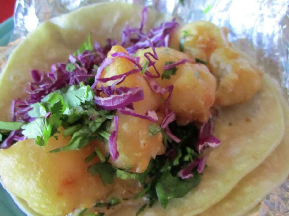 Berryhill Baja Grill tops off its fried fish tacos with red cabbage. Photo: Syd Kearney, HC Staff / Houston Chronicle