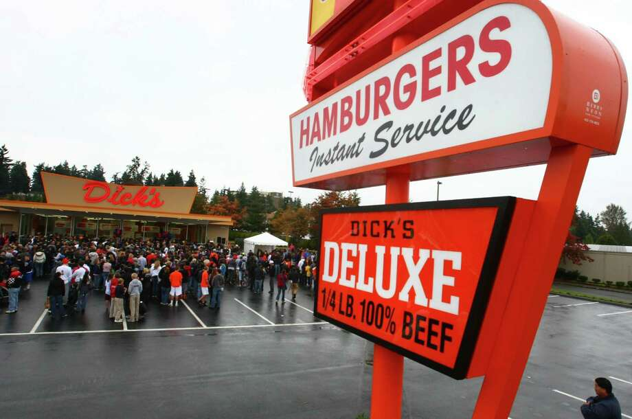 Dick's burgers: Not the juiciest patty ever, but a burger, shake and limp, salty fries at this orange drive-in is a quintessential Seattle experience. Or Edmonds, pictured, site of the newest Dick's. Photo: JOSHUA TRUJILLO / SEATTLEPI.COM