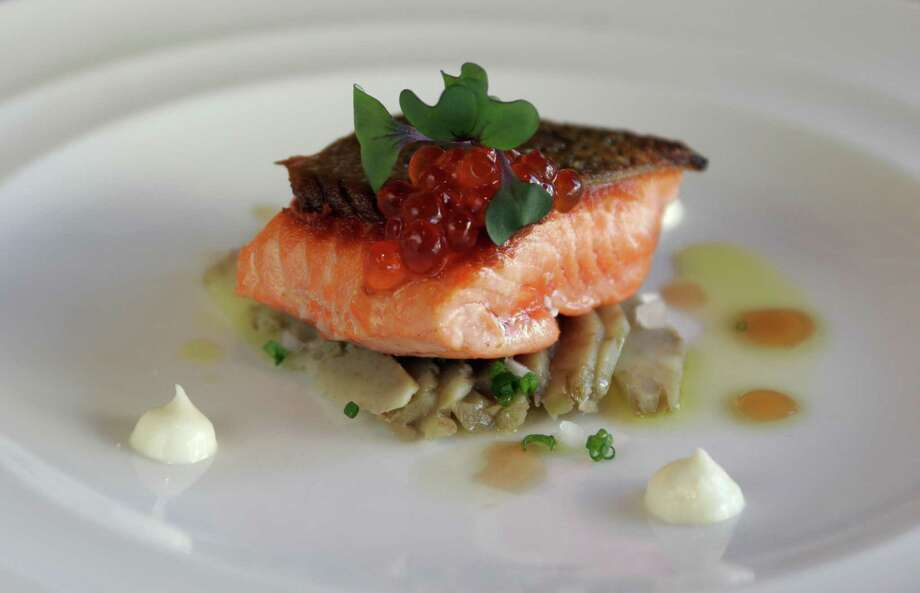 Salmon:Seattle's signature fish, from backyard grills to high-end menus. Pictured is Copper River sockeye at Portage in Queen Anne, with artichoke salad, creme fraiche and salmon caviar. Photo: Meryl Schenker / Seattle Post-Intelligencer