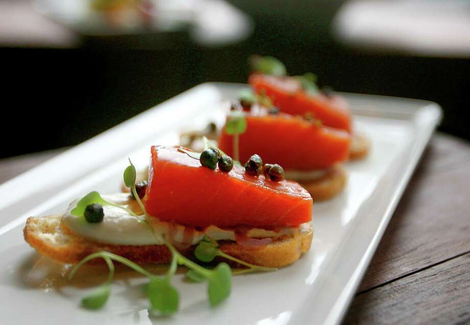 Smoked salmon: What do tourists always buy for home? Coffee and smoked salmon. It's good on crostini with capers at Spur Gastropub. Photo: Scott Eklund / Seattle Post-Intelligencer