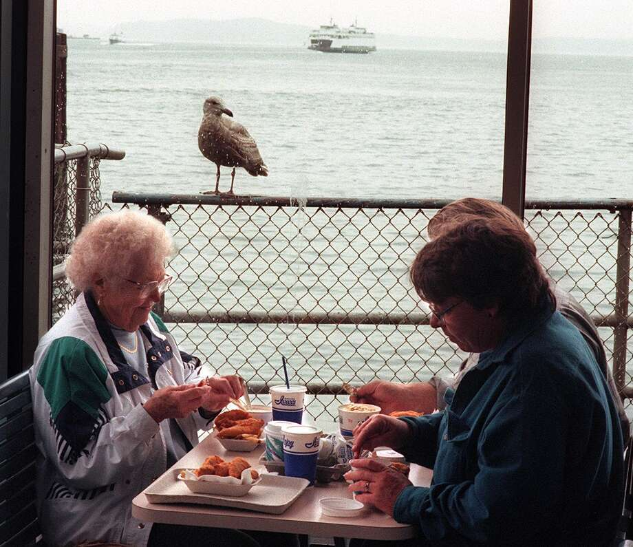 Ivar's: Beloved for its keep clam kitsch, fish and chips and clam chowder. Sharing it with a seagull and view of Puget Sound makes it taste better. Photo: SCOTT EKLUND / Seattle Post-Intelligencer
