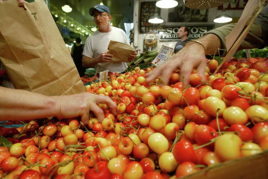 Rainier cherries: Locals know these cherries outshine boring Bings, and that they're great from the Pike Place Market. Suggestion via Bill Harper on Facebook. Photo: DAN DeLONG, SEATTLE POST-INTELLIGENCER / Seattle Post-Intelligencer