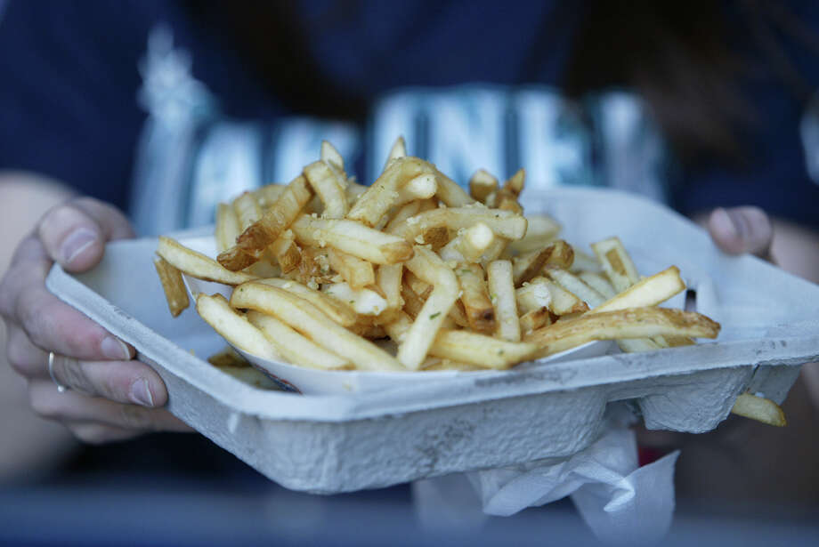 Garlic fries at Safeco Field: The smell of garlic on hot Ivar's fries at a Mariners game? Definitely summer in Seattle. Via Toshi Shagbaghlian on Facebook. Photo: Joshua Trujillo, Seattle Post-Intelligencer / Seattle Post-Intelligencer