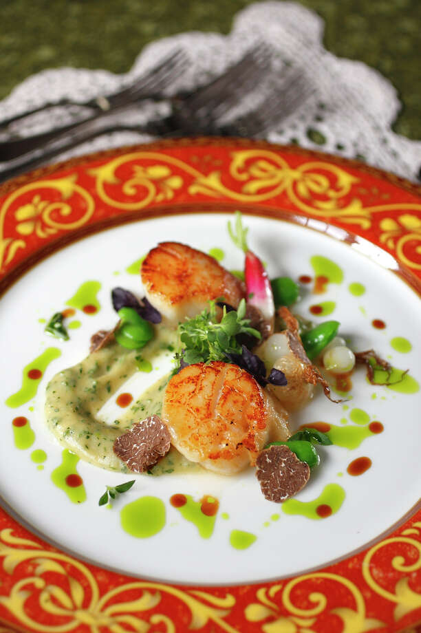 Pacific Northwest cuisine: Sounds made-up, but it's basically using fresh, local, seasonal ingredients, popularized by places like the Herbfarm. A typical dish: Kodiak Island scallops, salt-herring brandade, Oregon white truffles, Herbfarm bunching onions, and basil tips. / SEATTLE POST-INTELLIGENCER