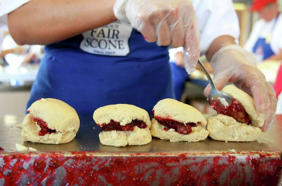 Puyallup Fair scones are symbolic of Washington's most famous fair, despite slight spongey blahness. But who cares when you're doing the rides. Suggestion via Judy Anderson McNeal on Facebook. Photo: Scott Eklund / Seattle Post-Intelligencer