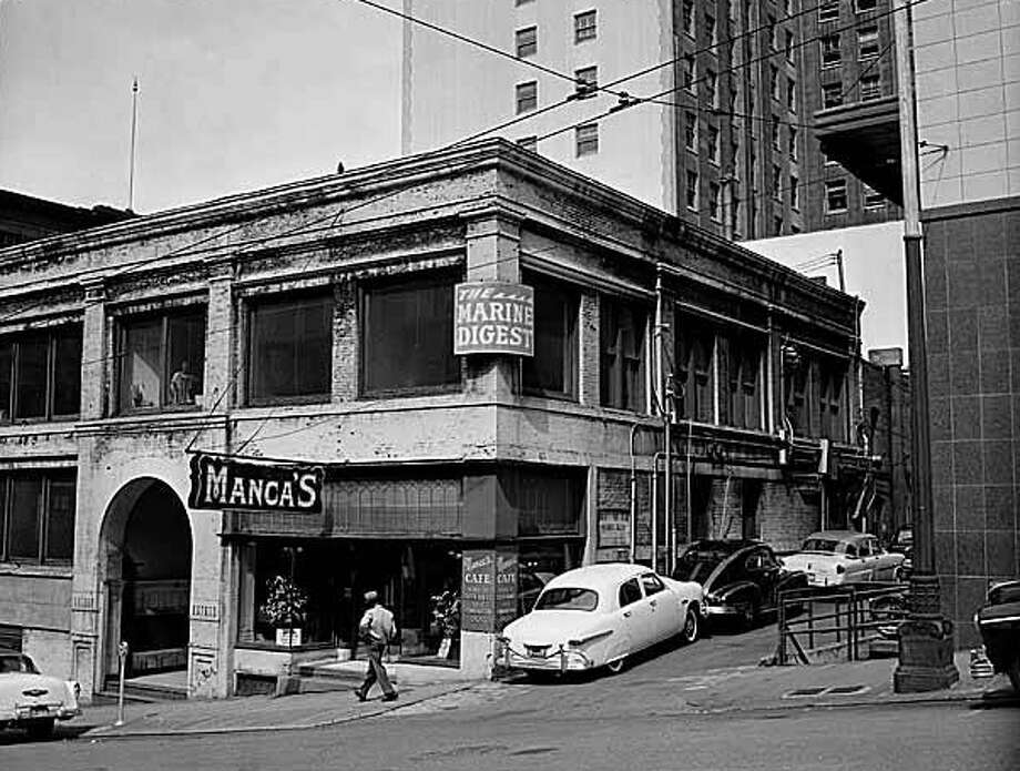 Manca's Cafe in downtown Seattle, shown here in 1955, made Dutch babies popular in the 1940s selling them for 90 cents. (MOHAI/seattlepi.com file)
